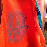YAP designed and hand screen printed the ArtHaus aprons.